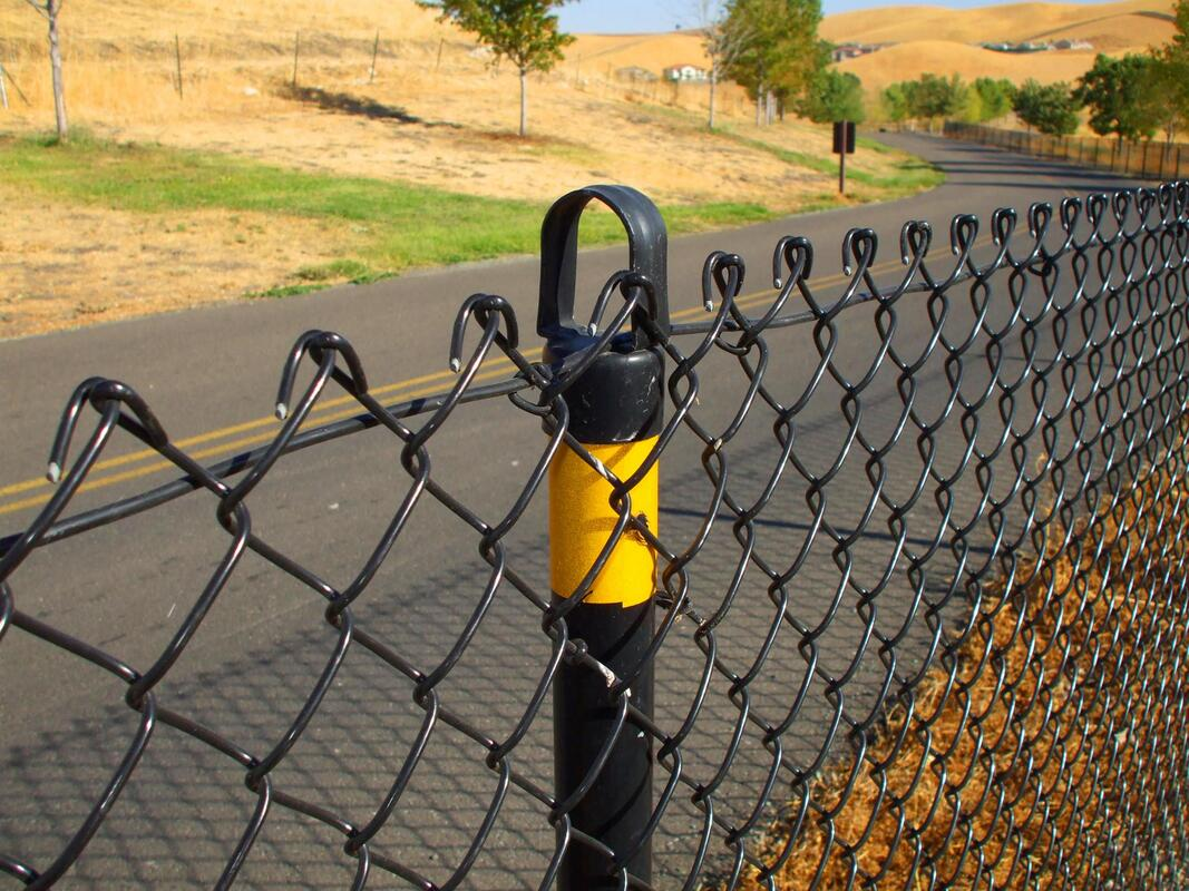 a black metal chianlink fence
