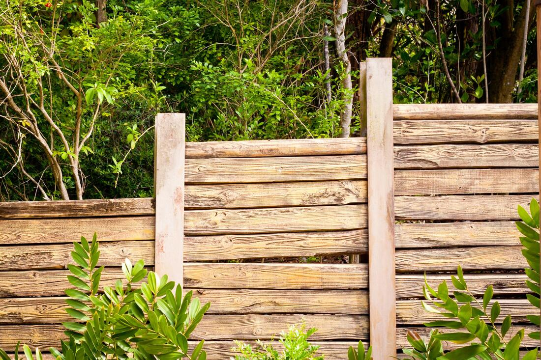 a flat log wood fence